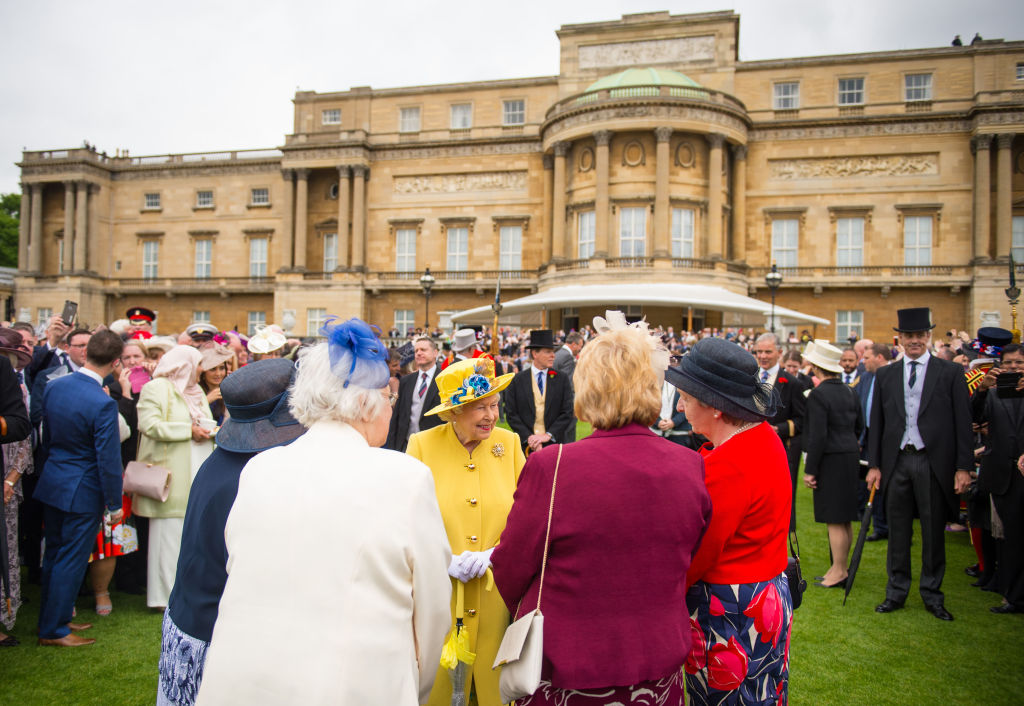 Britain's Queen Elizabeth II greets guests, after observing a minute's silence at the start of a Special Garden Party at Buckingham Palace