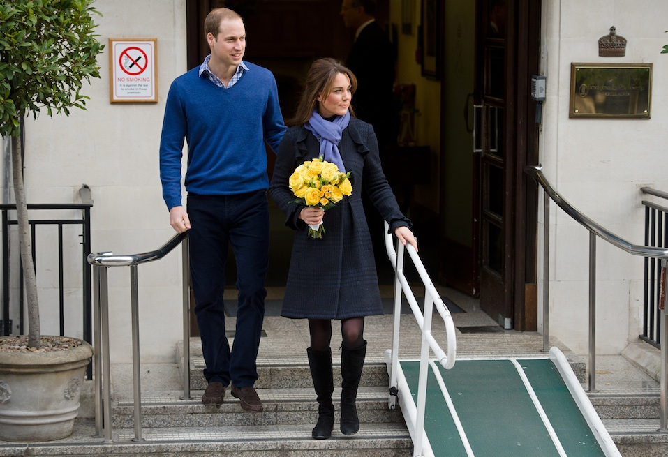 Britain's Prince WiIliam, the Duke of Cambridge, and his wife Catherine, Duchess of Cambridge, leave the King Edward VII hospital in central London,