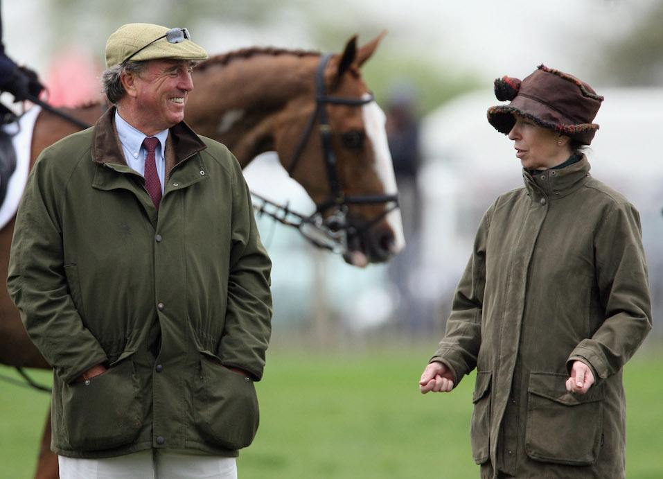 Princess Anne, Princess Royal jokes with her ex-husband Mark Phillips before the show jumping