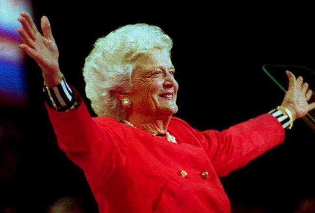 First Lady Barbara Bush posing in front of a crowd.