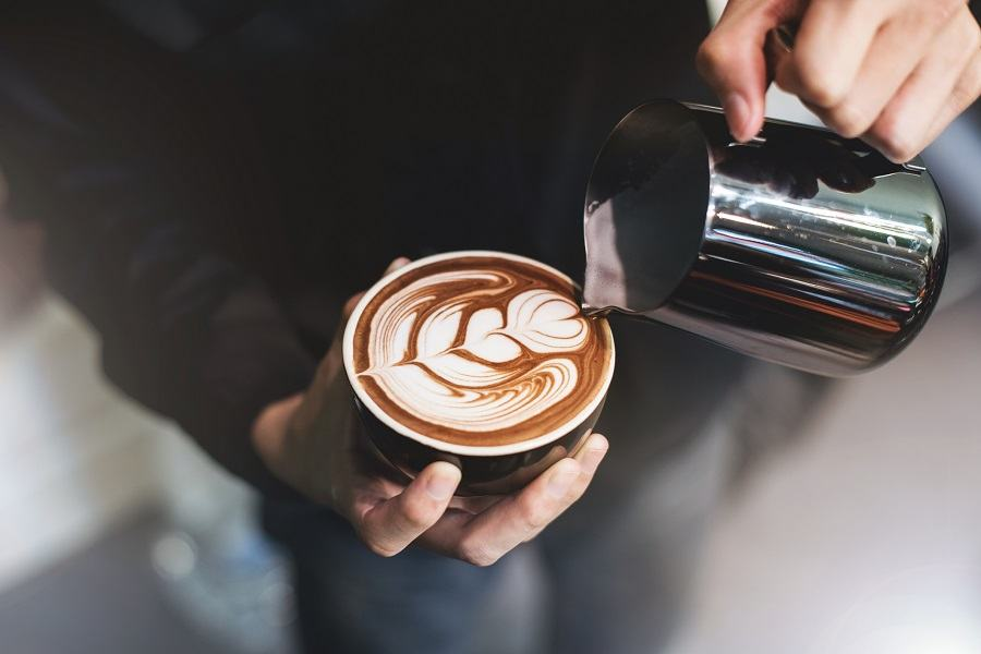 Baristo making coffee