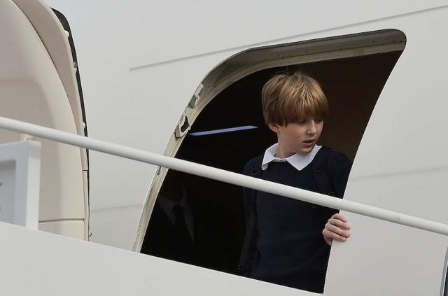 Barron Trump walking out of a plane.