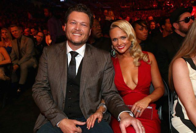 Blake Shelton and Miranda Lambert sitting together at an awards show.