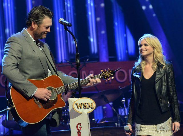 Blake Shelton and Miranda Lambert performing on stage.