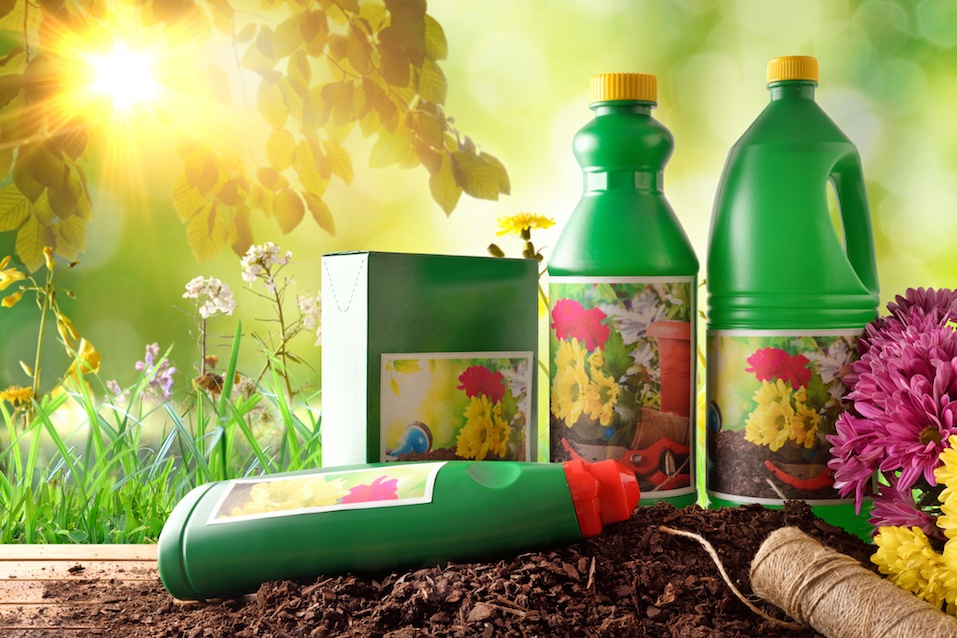 Bottles and containers of gardening products for the growth of plants