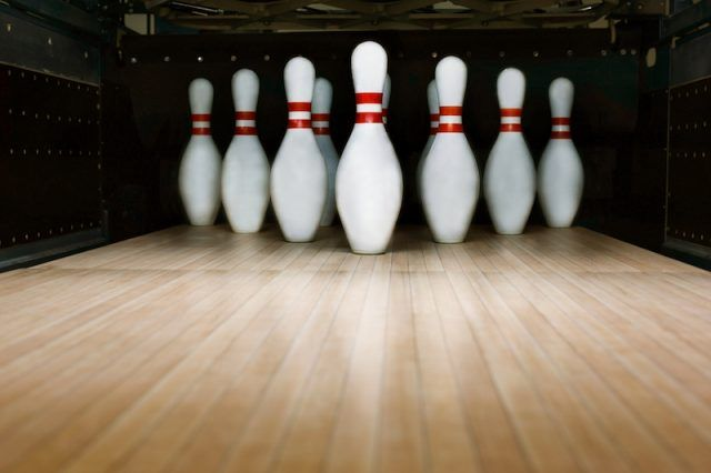 Red and white bowling pins.