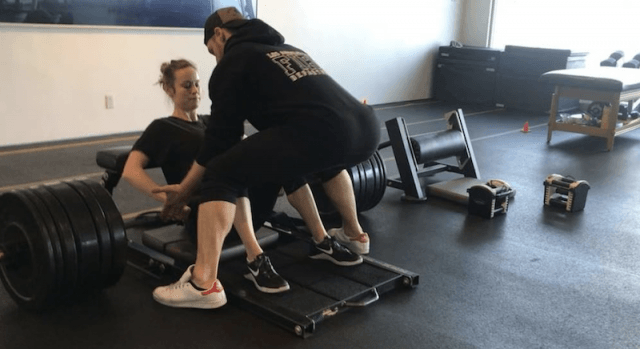 Brie Larson training at the gym with her trainer.