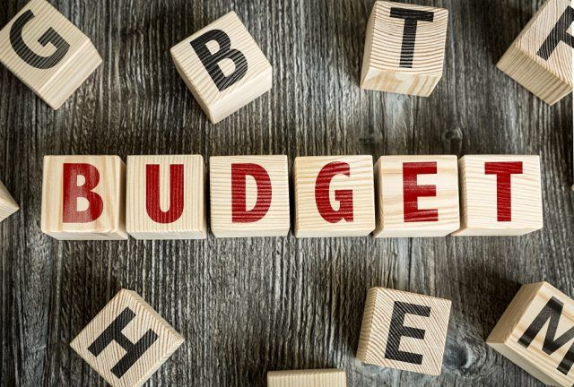Wooden Blocks with the text: Budget