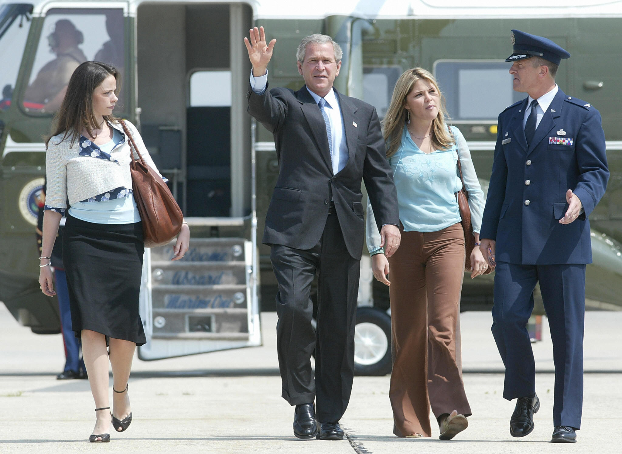 US President George W. Bush (C) walks with his daughters Jenna and Barbara