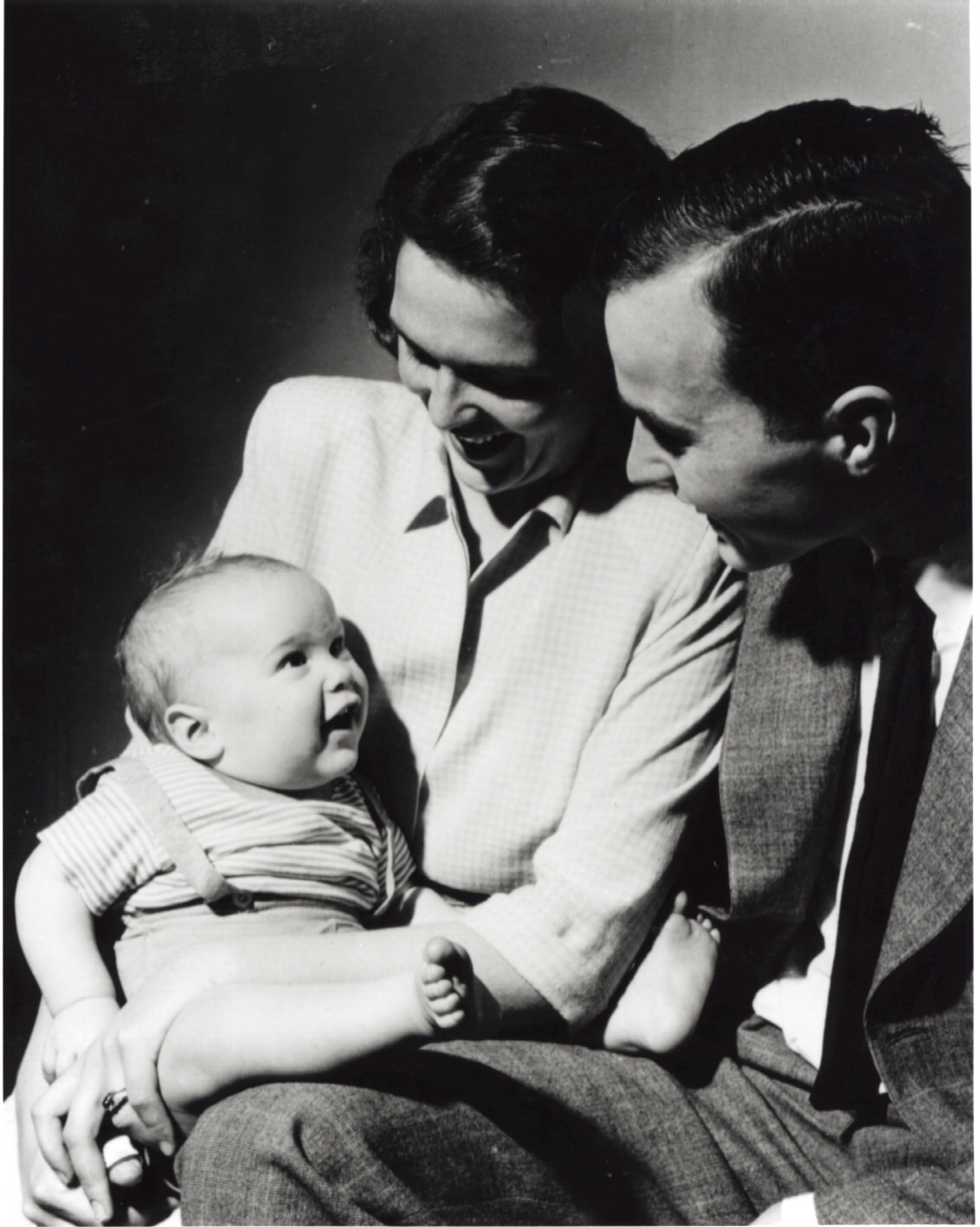 An infant George W. Bush with his mother Barbara Bush and his father George Bush posing for a portrait in New Haven, CT, April 1947.