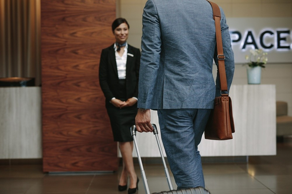 Businessman carrying suitcase