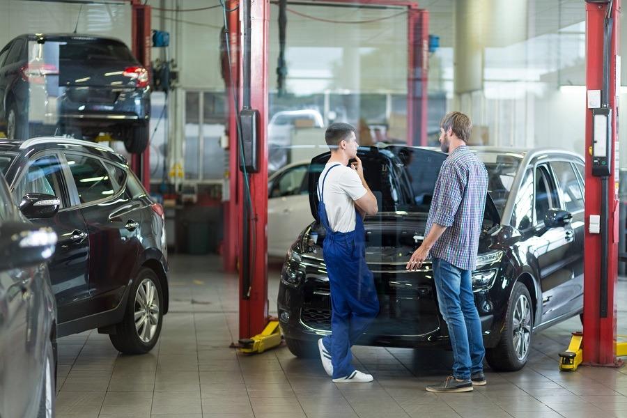 Man having problems with car visiting repair shop
