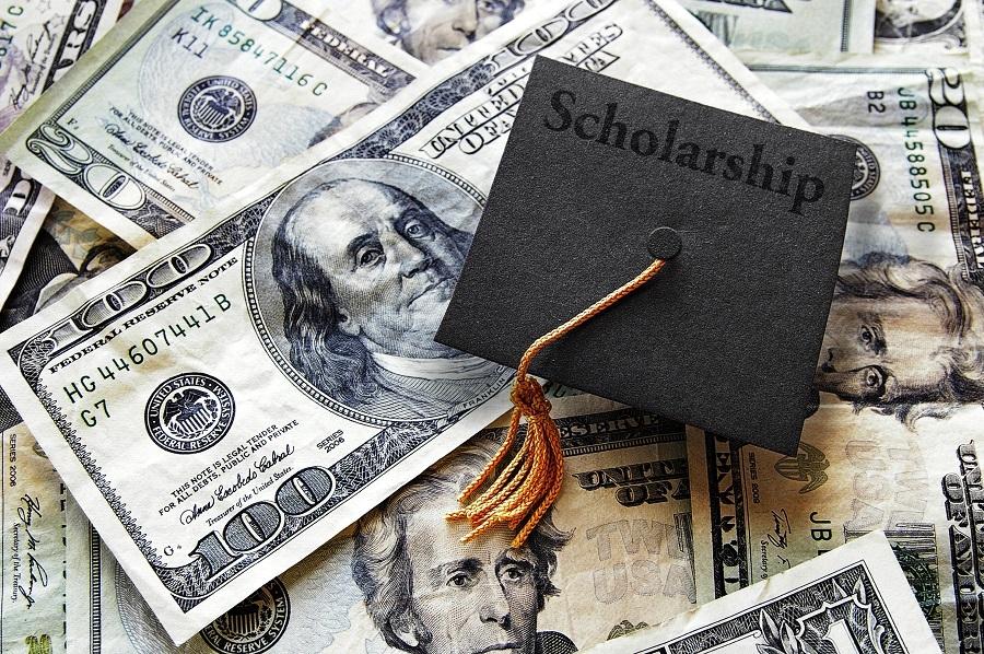 Graduation cap with dollar bills