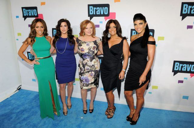 The RHONJ cast members posing together at a Bravo event.