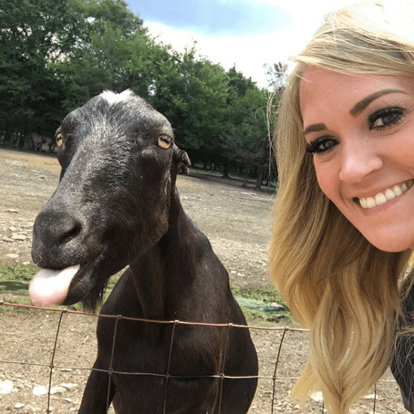 Photo of Carrie Underwood with a goat