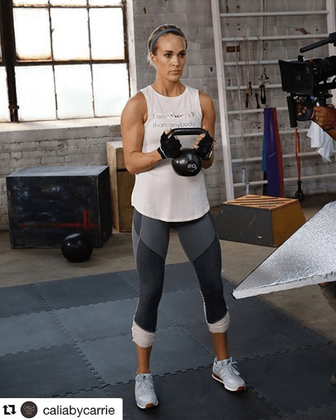 Carrie Underwood holding a weight, ready to work out