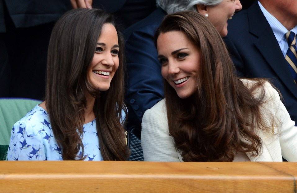 Catherine, Duchess of Cambridge and her sister Pippa Middleton talk in the Royal Box