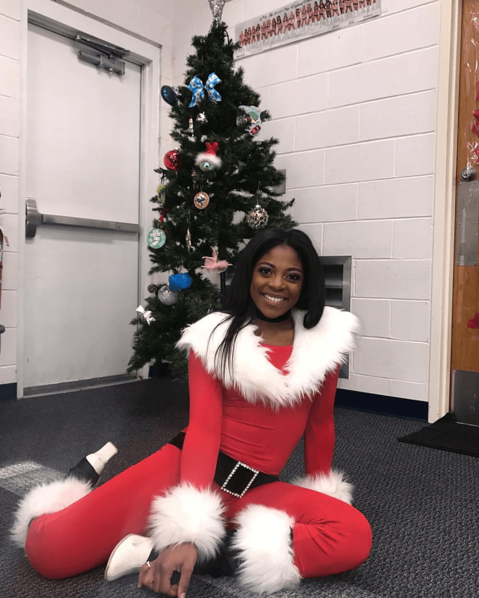 NFL Cheerleader sitting in santa costume