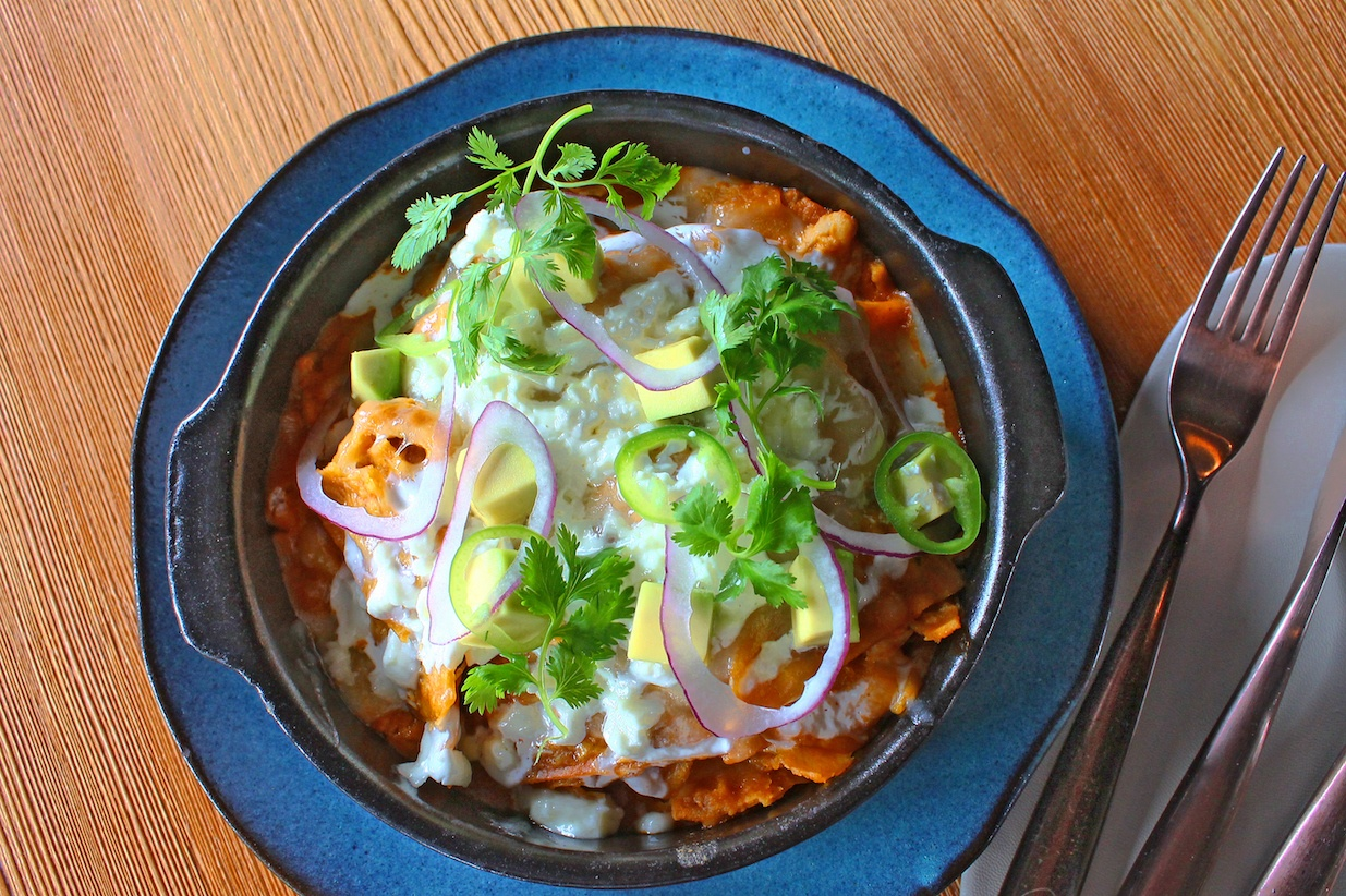 Chilaquiles mexican dish wooden table