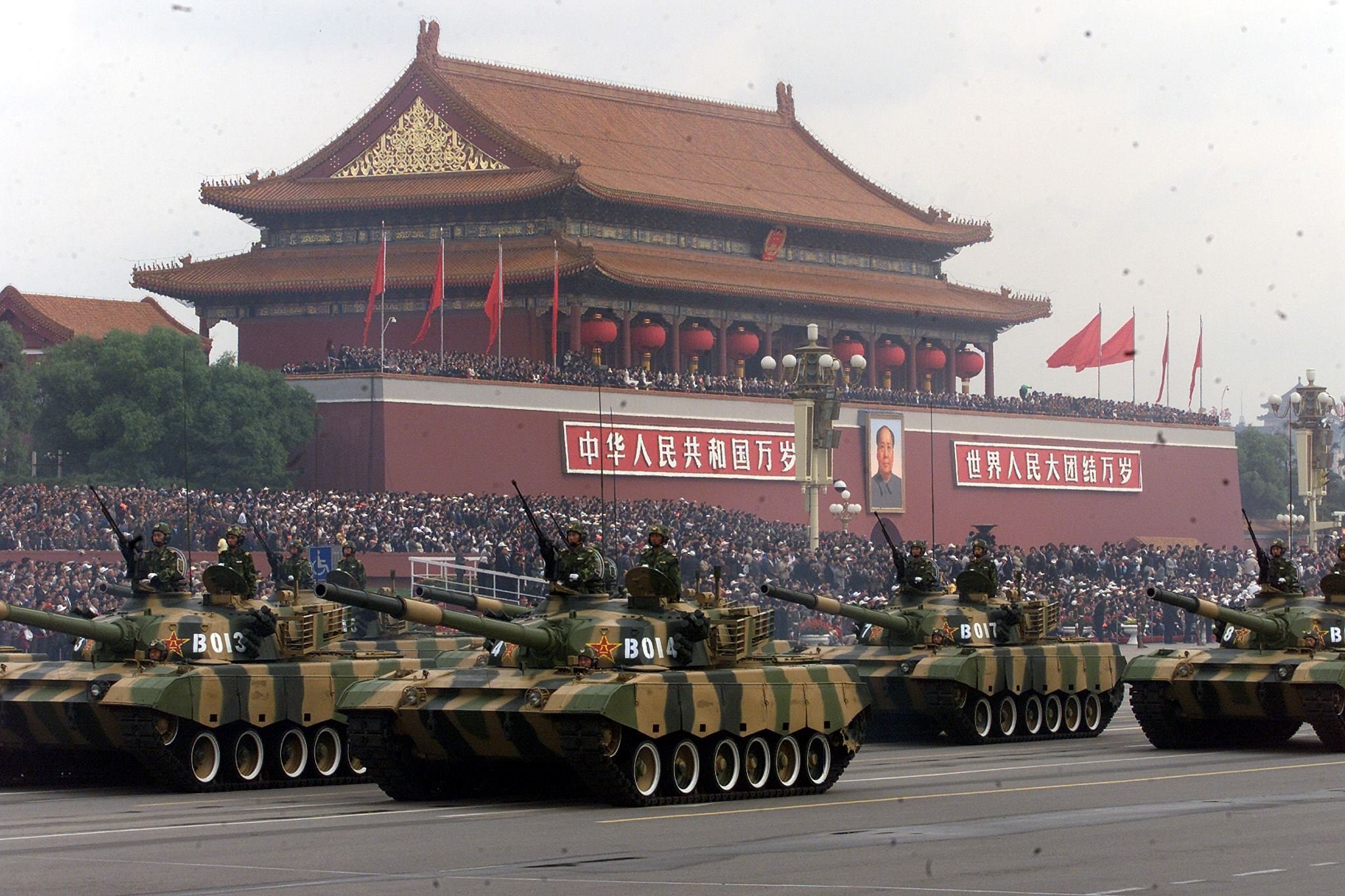 People's Liberation Army tanks roll past Beijing's Tiananmen Gate