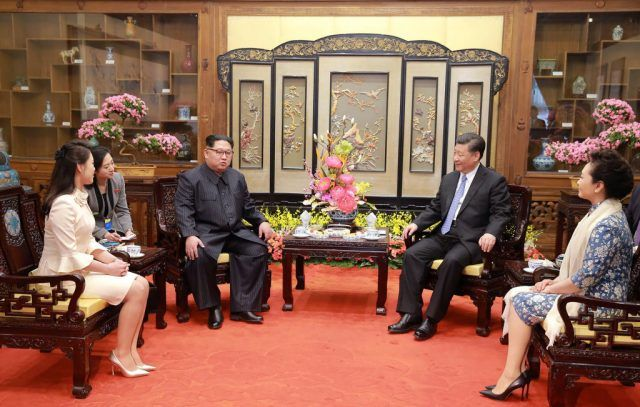 Kim Jong Un and Ri Sol-Ju in China with President Xi Jinping.