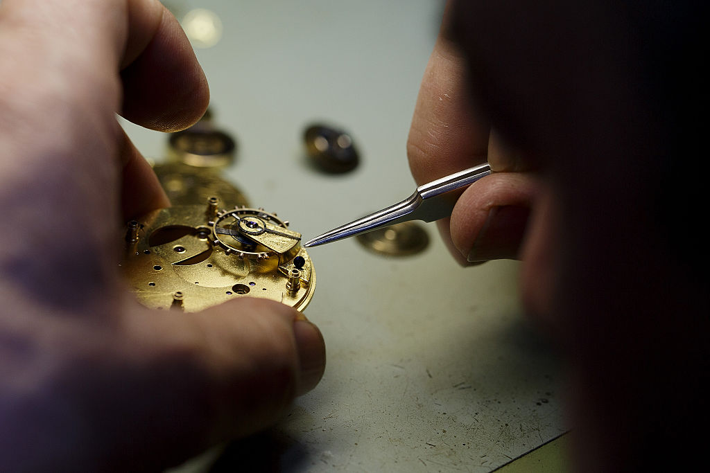 Watchmaker repairs a pocket watch