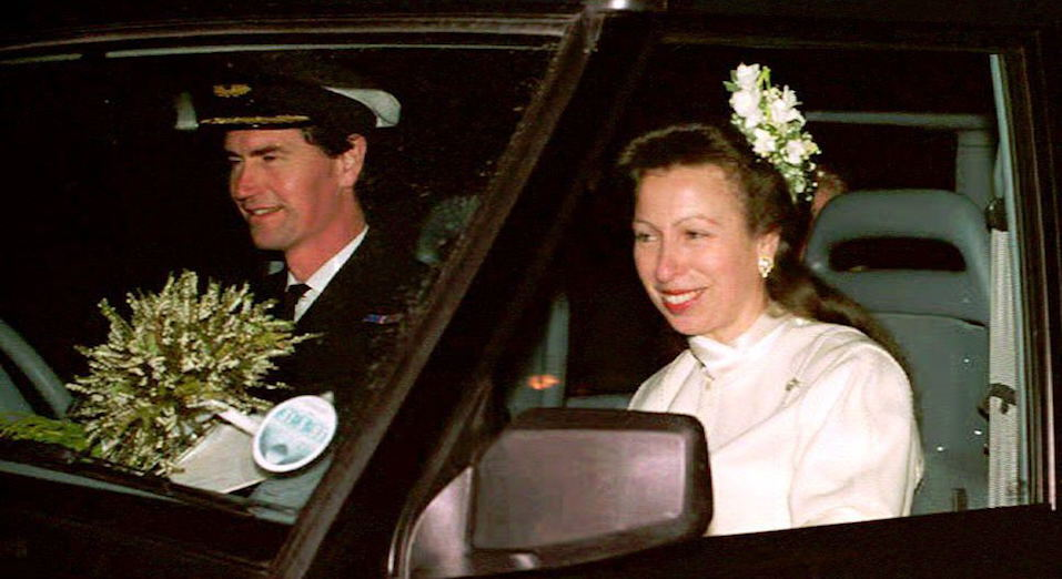 Commander Tim Laurence and Britain's Princess Anne are seen in their car after their wedding at Crathie Church