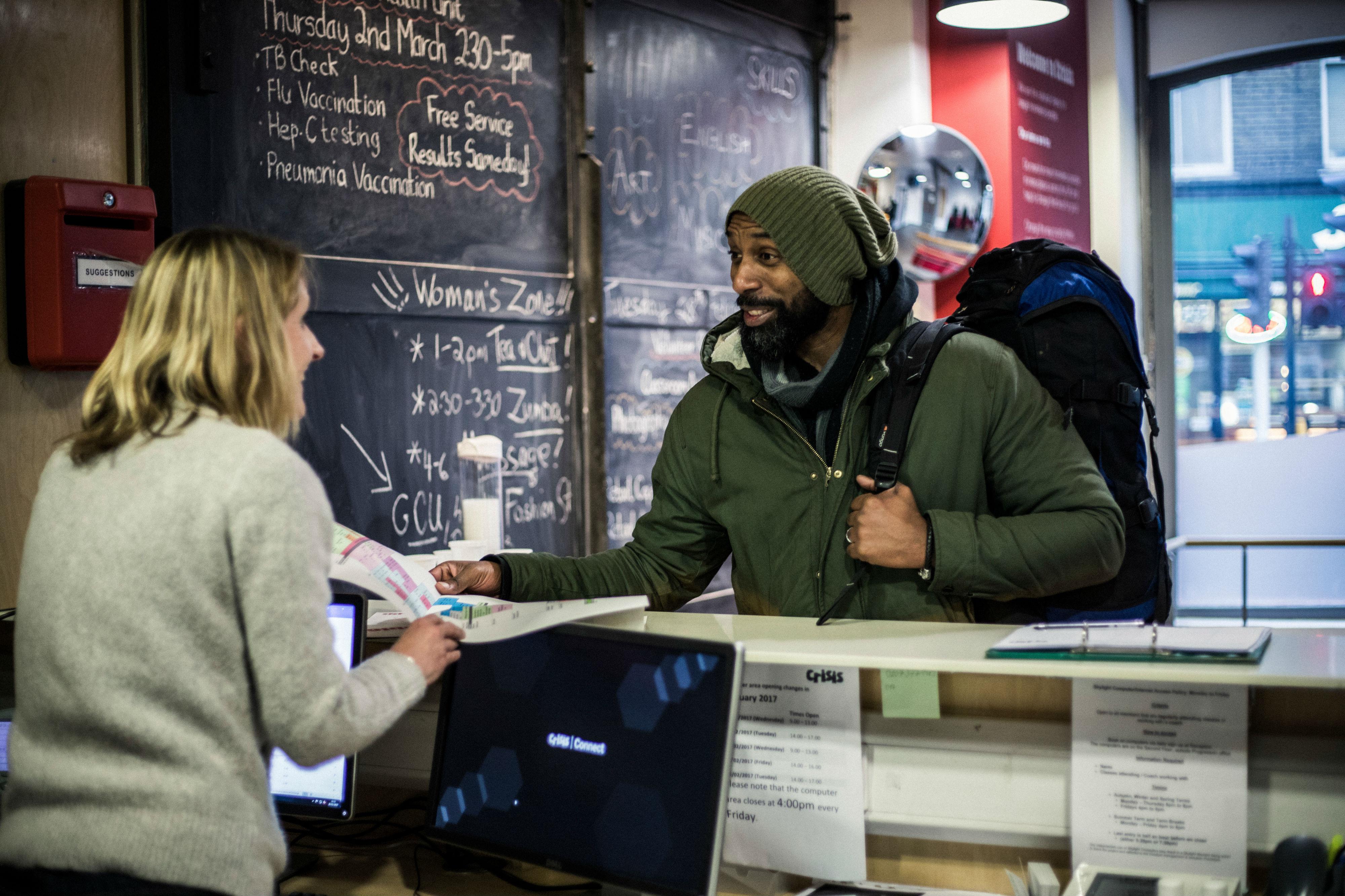 Homeless man entering Crisis charity center
