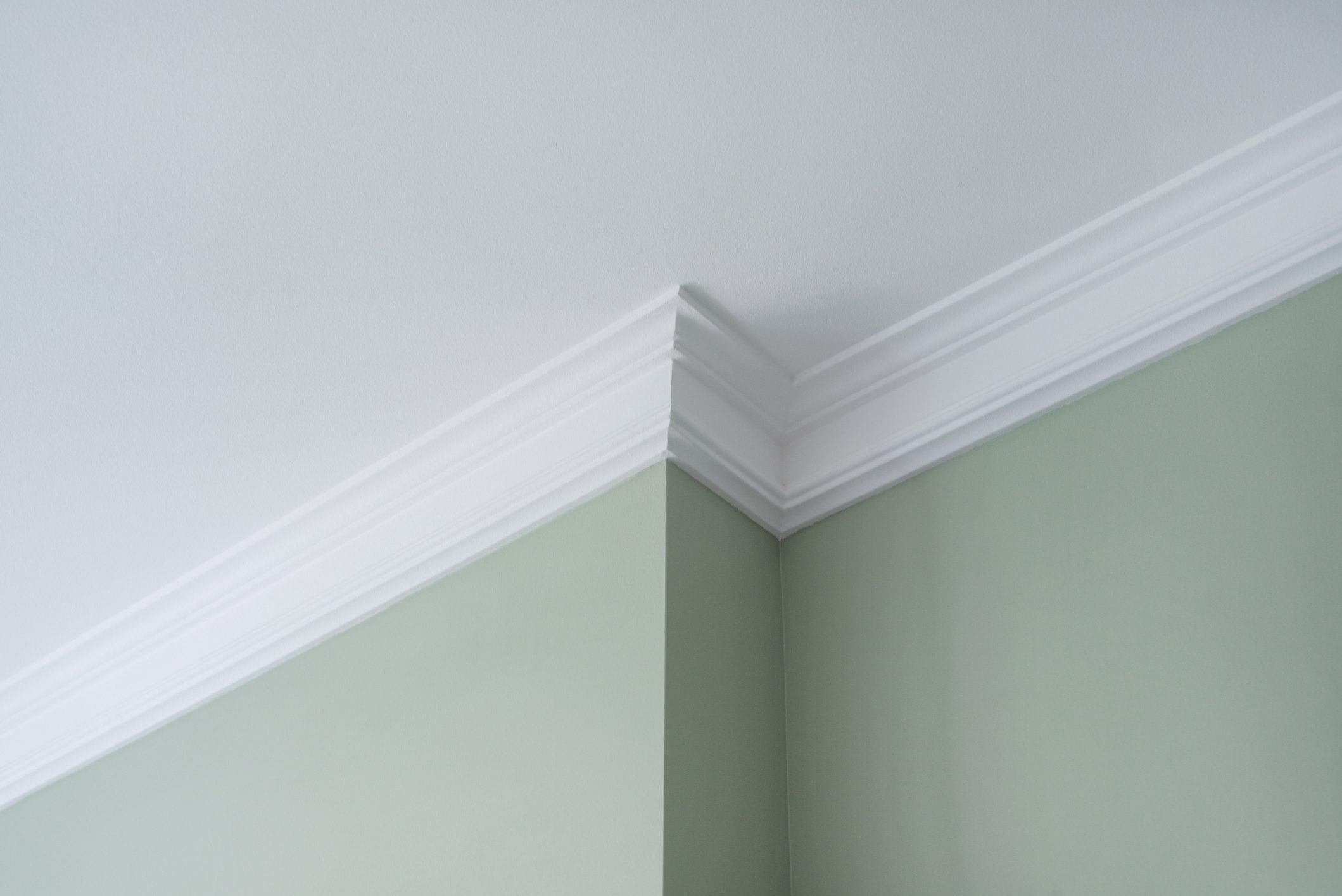 Ceiling crown moldings in the interior, detail of intricate corner.