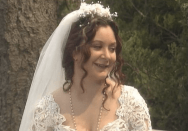 Darlene smiling while in her wedding dress.