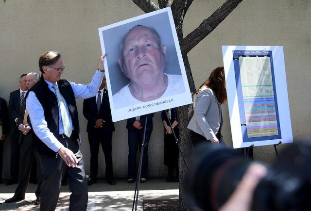 Officials holding DeAngelo's photo during a press conference.