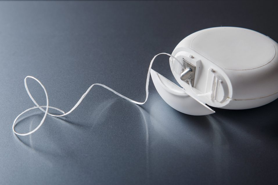 Container with dental floss