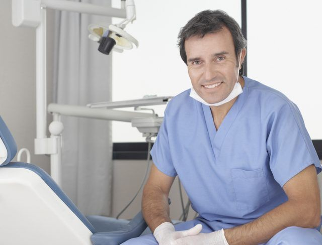 Dentist sitting in his office