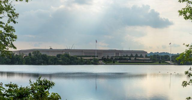 The Department of Defense seen across a lake.
