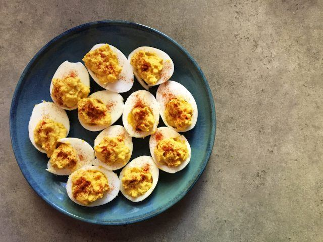 Devilled eggs on blue plate
