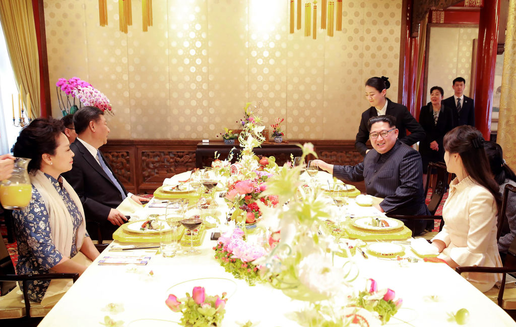 Kim Jong Un and Ri Sol-Ju in China with President Xi Jinping
