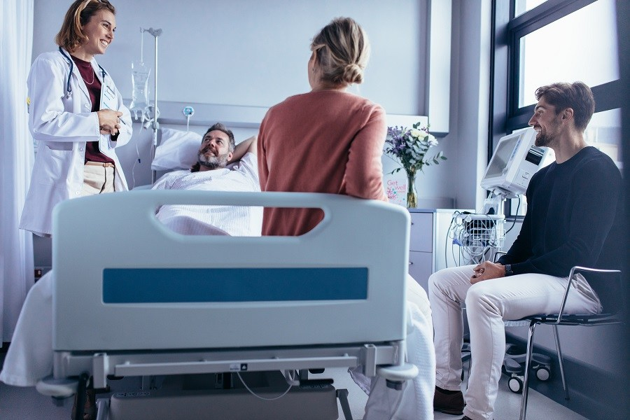 doctor attendants and Patient lying on bed