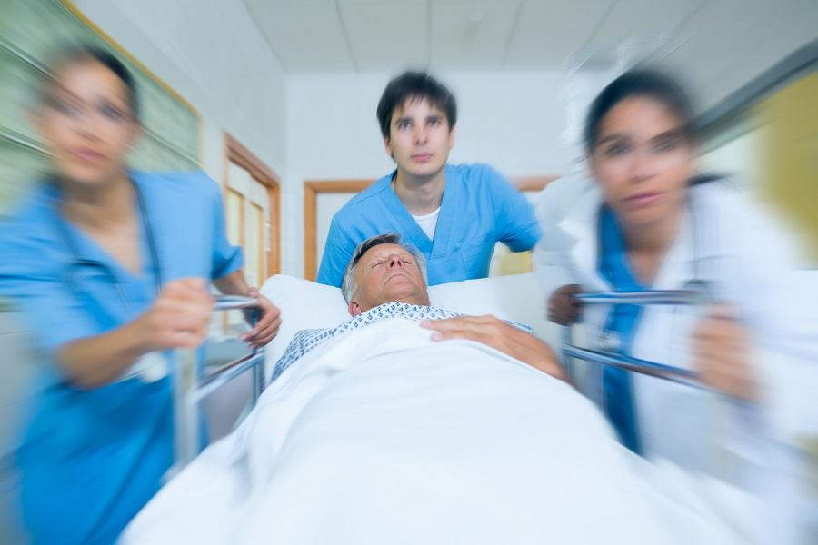 Doctors rushing with patient