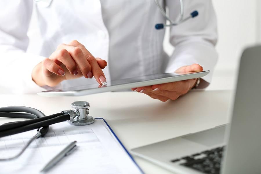 Doctor checking tab