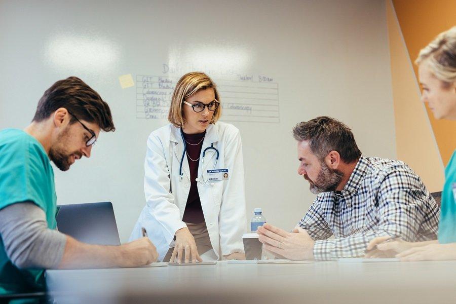 Doctor explaining reports