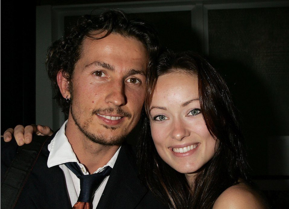 Actress Olivia Wilde poses with her husband filmmaker Tao Ruspoli