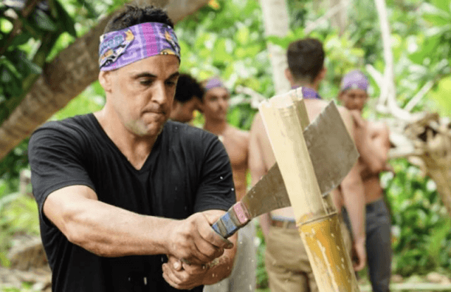 Domenick cutting down a piece of bamboo.