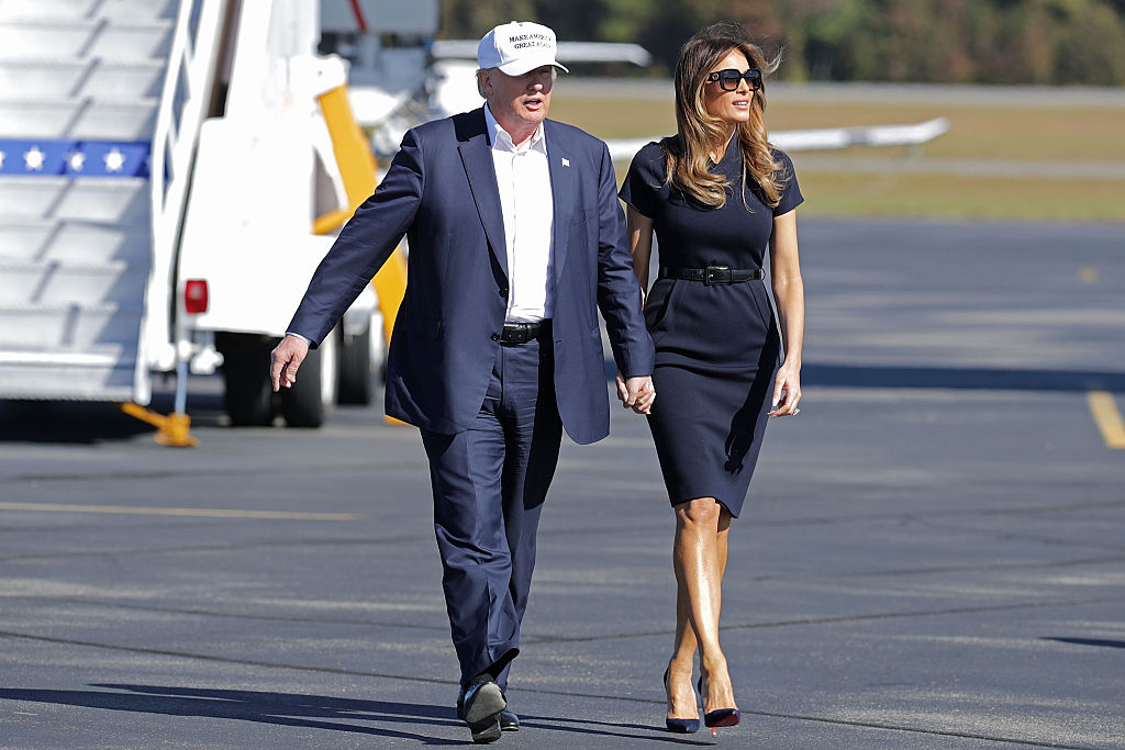 Republican presidential nominee Donald Trump and his wife Melania Trump arrive for a campaign rally