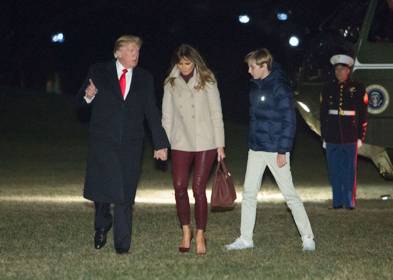 Melania Trump walking with Donald Trump and Barron Trump