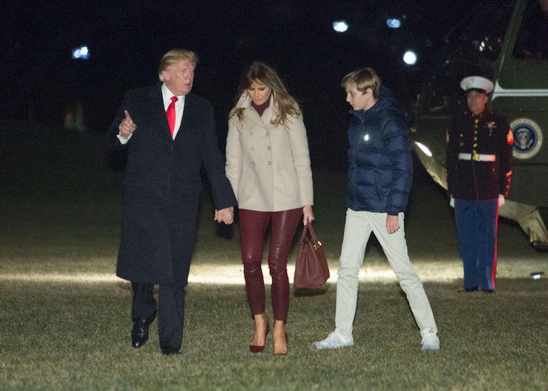 Melania Trump walking with Donald Trump and Barron Trump