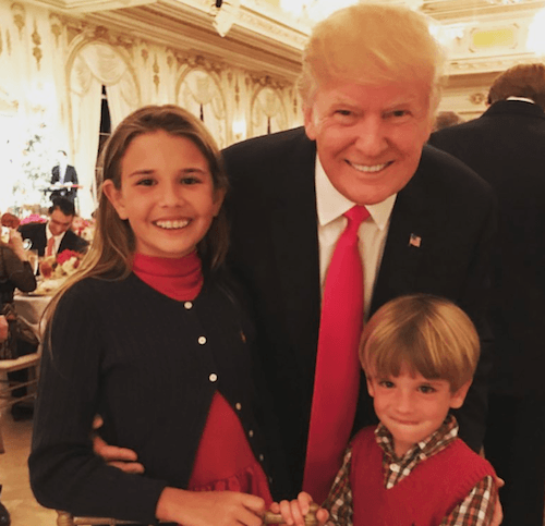 Donald Trump poses with two of his grandchildren.