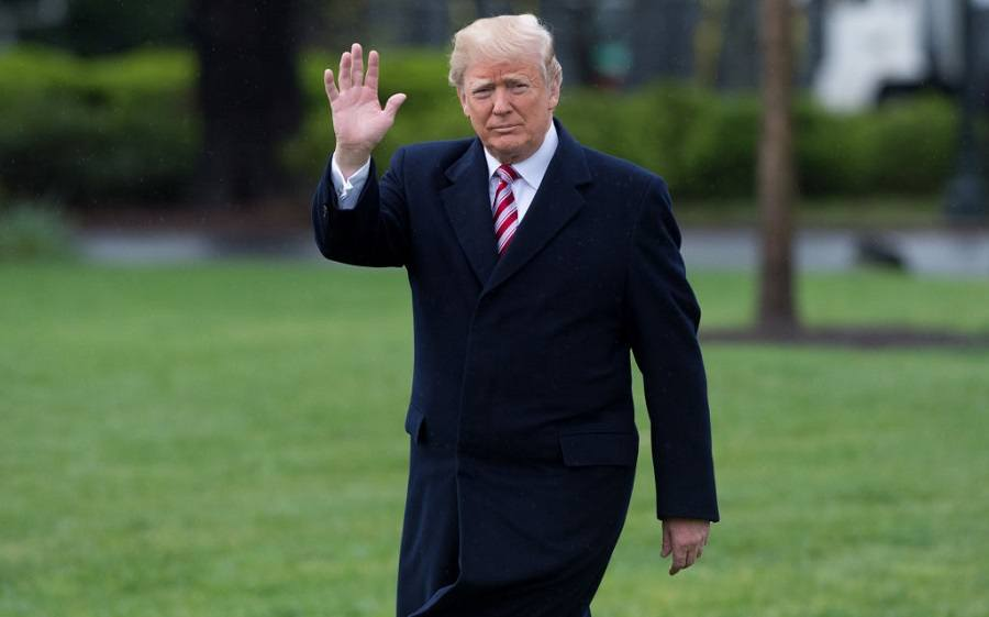 US President Donald Trump walks to Marine