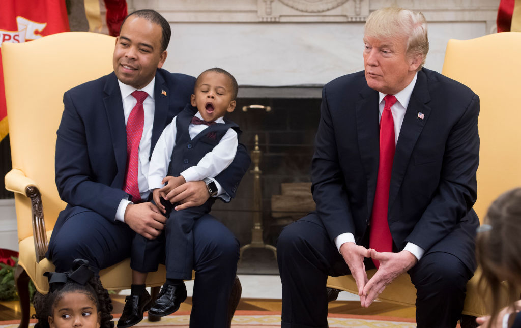 Donald Trump with a yawning child