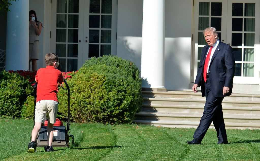 Trump watches Frank Giaccio, 11, of Falls Church, Virginia, as he mows the lawn