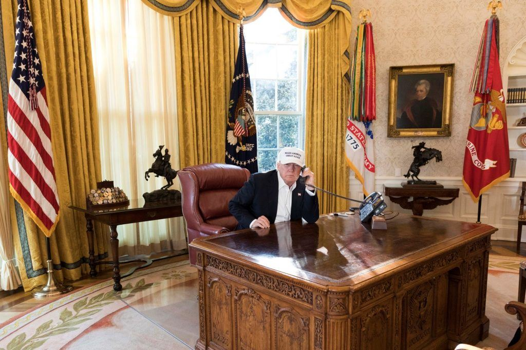 Donald Trump working in oval office